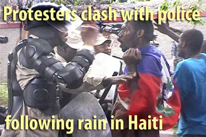 Protesters clash with police following rain in Haiti - February 11, 2010